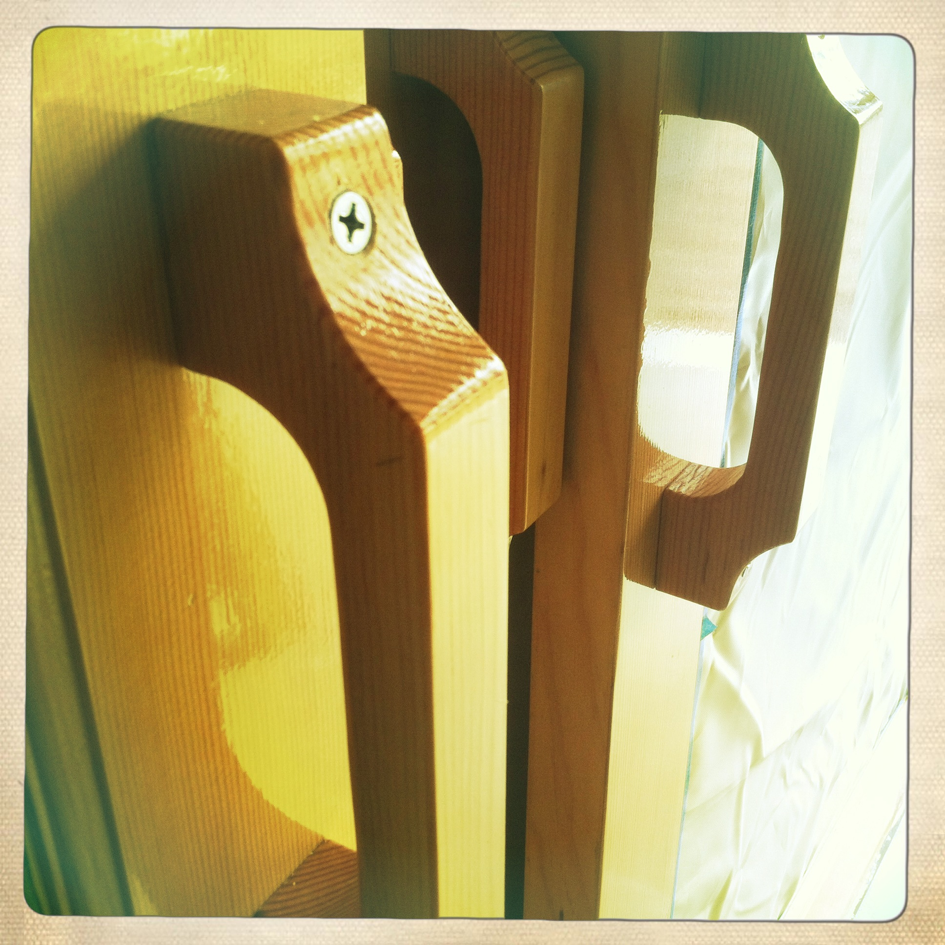 Handmade varnished door handles for the tent at Castle Hill Inn.