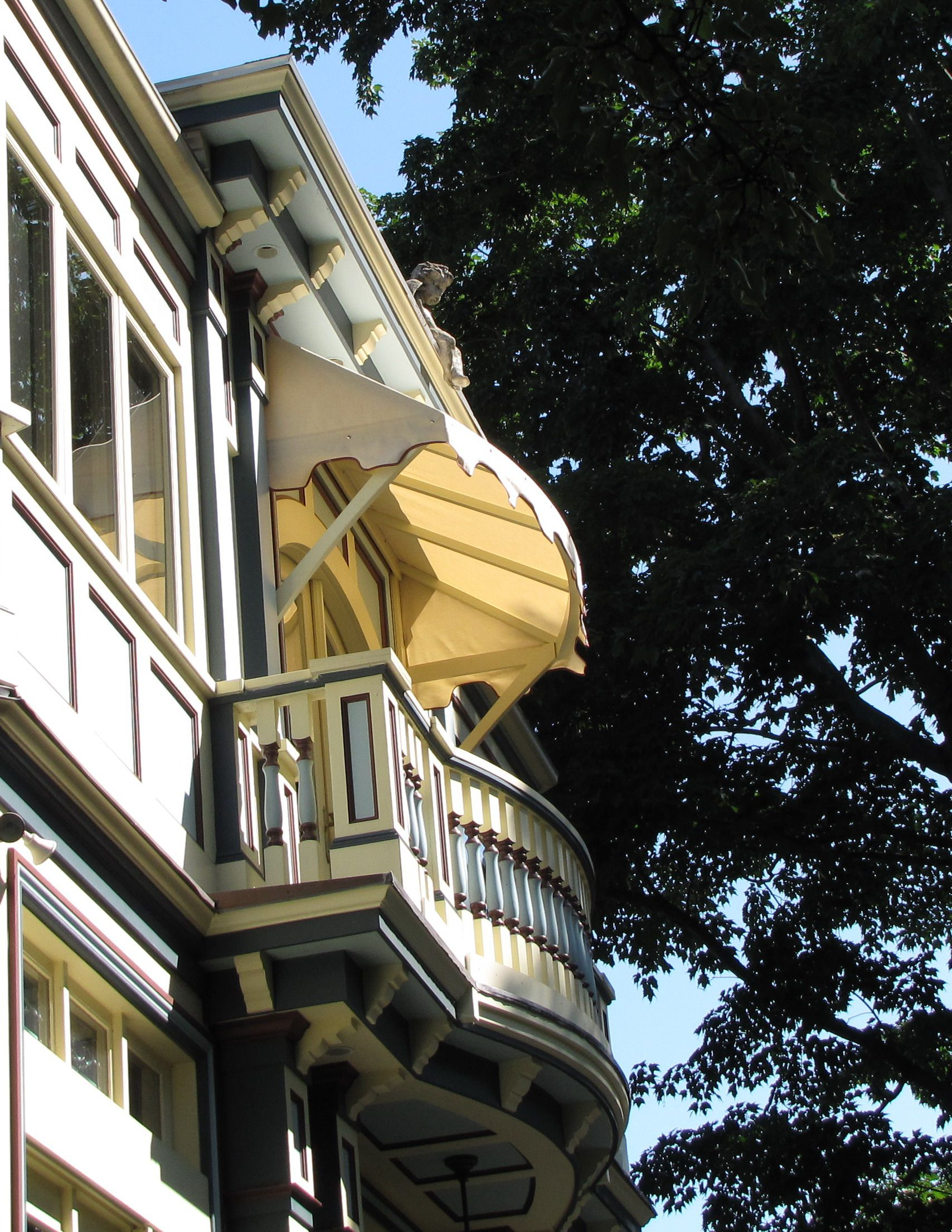 This wood framed window awning matches the architecture of the house well.